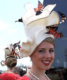 Fashion hat by Louise Macdonald won third prize in the Professional Millinery Competition at the Melbourne Spring Racing Carnival 2008; the hat was made from parisisal straw, sinamay and tinted feathers