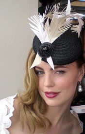 Actress Melissa George wearing mini beret designed by Melbourne milliner Louise Macdonald on Derby Day 2007