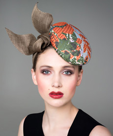 Fashion hat Green and Orange 'Stella' Headpiece, a design by Melbourne milliner Louise Macdonald