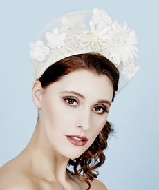 Fashion hat Headra Headpiece in Cream, a design by Melbourne milliner Louise Macdonald