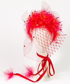 Fashion hat Alora in Red with Veil, a design by Melbourne milliner Louise Macdonald