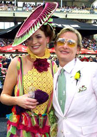 Wearing a fashion hat by Louise Macdonald Milliner, model Ruth Jackman meets Carson Kressley at the 2005 Melbourne Cup