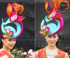 Melbourne's Oaks Day 2013 and Louise Macdonald's entry in the professional millinery competition: model Jodie Fiala wore a sculpted sinamay piece trimmed with flowers and berries (the bird was made of fabric and feathers)