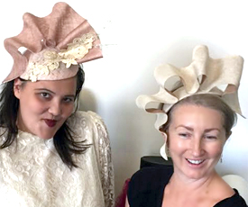 Millinery students Maya and Sam model the fruits of their labor in the Twist and Shape Sinamay Manipulation course