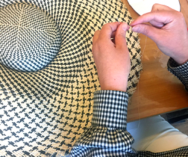 Participant of a workshop at Louise Macdonald Milliner's studio in Melbourne creates a Dior style brimmed hat from a buntal mat (February 2019)