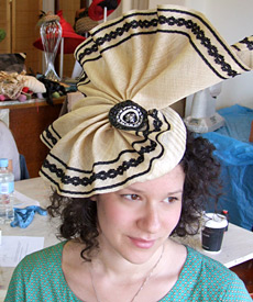Student wearing her fashion hat created during millinery workshop at Louise Macdonald's studio in Melbourne (2009)