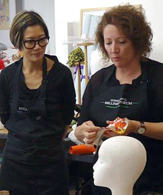 Carole Maher (left), a visiting tutor in the 2014 Millinery Summer School, introduced students to new materials being used in millinery: thermoplastics